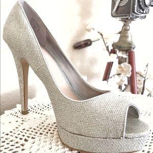 "Silver, peep-toe, 5"" heels (w/platform). Aldo."